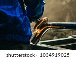 metal polishing with a hand... | Shutterstock . vector #1034919025