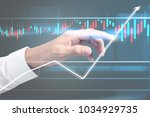 investment concept hand with...   Shutterstock . vector #1034929735