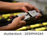 employee are using hand picks... | Shutterstock . vector #1034944264