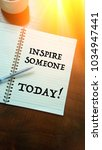 Small photo of Inspire someone today quote written on the book with sun ray filter