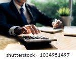 businessman accouting... | Shutterstock . vector #1034951497