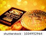 golden bitcoin token with a... | Shutterstock . vector #1034952964