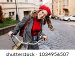 smiling female model with curly ... | Shutterstock . vector #1034956507