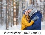 portrait of happy young couple... | Shutterstock . vector #1034958514