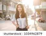 young beautiful female traveler ... | Shutterstock . vector #1034962879