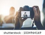 the photographer to take a... | Shutterstock . vector #1034964169
