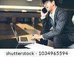 handsome businessman in suit... | Shutterstock . vector #1034965594