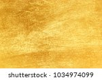 shiny yellow leaf gold texture... | Shutterstock . vector #1034974099