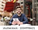 prosperous businessman speaking ...   Shutterstock . vector #1034998621