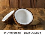 fresh coconuts on old wooden... | Shutterstock . vector #1035006895