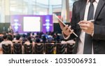 businessman using the tablet on ... | Shutterstock . vector #1035006931