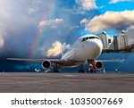passenger airplane at the... | Shutterstock . vector #1035007669