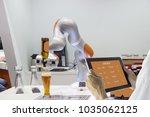 industry 4.0 robot concept ... | Shutterstock . vector #1035062125