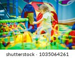 child is playing in the... | Shutterstock . vector #1035064261