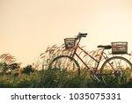 retro bicycle in summer grass... | Shutterstock . vector #1035075331