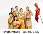 indian family celebrating gudi... | Shutterstock . vector #1035079237