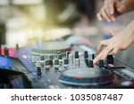 close up of dj's hand playing... | Shutterstock . vector #1035087487