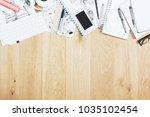 top view of wooden office desk... | Shutterstock . vector #1035102454