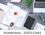 top view of modern messy desk...   Shutterstock . vector #1035111661