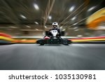 the man is going on the go kart ... | Shutterstock . vector #1035130981