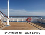 wooden wharf buoy and blue sky | Shutterstock . vector #103513499