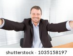 businessman in a suit makes a... | Shutterstock . vector #1035158197