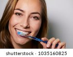 beautiful woman brushing teeth  ... | Shutterstock . vector #1035160825