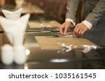 restaurant manager outting... | Shutterstock . vector #1035161545