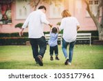 happy asian family walking and... | Shutterstock . vector #1035177961