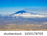 etna volcano from the airplane... | Shutterstock . vector #1035178705