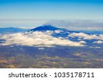 etna volcano from the airplane... | Shutterstock . vector #1035178711