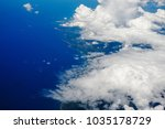 blue sky and clouds below from... | Shutterstock . vector #1035178729