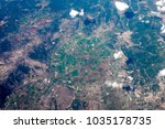 green agro fields from airplane ... | Shutterstock . vector #1035178735