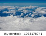 blue sky and clouds below from... | Shutterstock . vector #1035178741