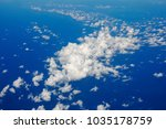 blue sky and clouds below from... | Shutterstock . vector #1035178759