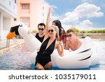 group of friends in swimsuit... | Shutterstock . vector #1035179011