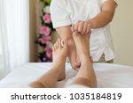asian girl relaxing having feet ... | Shutterstock . vector #1035184819