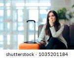 sad melancholic woman with... | Shutterstock . vector #1035201184