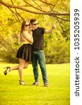 Small photo of Love romance relationship dating leisure concept. Affectionate couple in park. Girl and boy holding hands under tree.