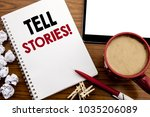 Small photo of Conceptual hand writing text caption inspiration showing Tell Stories. Business concept for Storytelling Telling Story written on notepad paper on the wood table with coffee in office