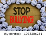 Small photo of Stop Bullying. Business concept for Prevention Problem Bully written on vintage background with space on old background with folded paper balls
