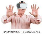 grandfather is looking at the... | Shutterstock . vector #1035208711