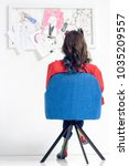 rear view of woman looking at... | Shutterstock . vector #1035209557