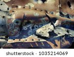 Small photo of Remains of military aircraft (fighter) punched shell fragments and warmed by explosions of shells and bullets, splinter effect, fragment effect. Shoot down an aircraft, grand slam