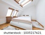 bedroom interior in luxury loft ... | Shutterstock . vector #1035217621