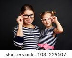 beautiful girl with her mom... | Shutterstock . vector #1035229507
