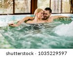 loving young couple relaxing in ... | Shutterstock . vector #1035229597