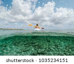 young lady paddling on single...   Shutterstock . vector #1035234151