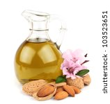 Small photo of almond oil and almond nuts with flowers on white background