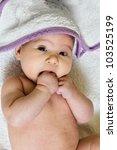 Adorable baby after bath, looking at camera. - stock photo